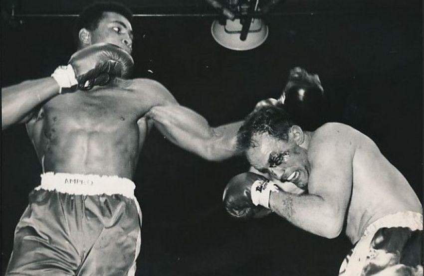 Mohammed Ali brutally beat Henry Cooper