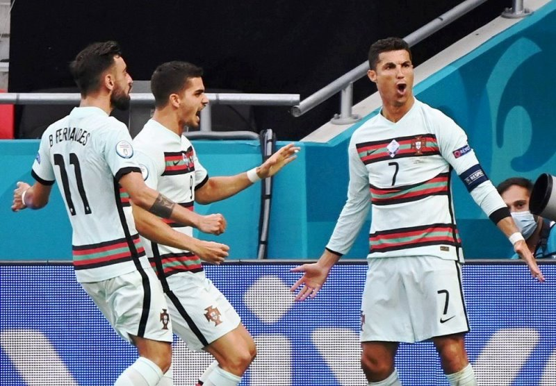 Cristiano Ronaldo's historic double helps Portugal sink stubborn Hungary. Highlights